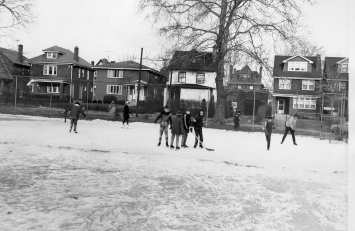 Boys playing ice hockey in Frick Park.